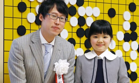 Sumire Nakamura poses in front of a Go board with professional player Yuta Iyama. She turns pro herself on 1 April 2019.