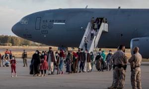 Afghan evacuees disembark from US Air Force plane at Rota Naval Base on August 31, 2021 in Rota, Spain.