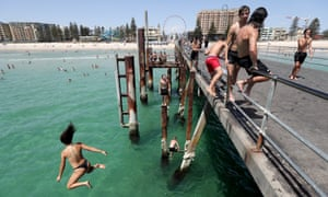 South Australia's hot weather will be worse than last week's. Teens jump off the jetty at Glenelg beach during a recent hot day.