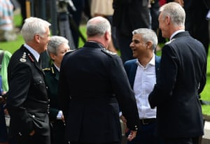 Britain's new London Mayor Sadiq Khan, (2R) speaks with Metropolitan Police Commissioner Bernard Hogan-Howe (R) and London Fire Commissioner Ron Dobson (L) folowing a ceremony at Southwark Cathedral