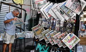 A man reads a newspaper on July 26, 2017 in Athens.