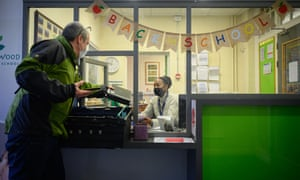 Restored laptops being delivered to Elm Wood primary school in south London