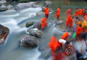 Hindu pilgrims collect holy water from the Bagmati river in Kathmandu, Nepal, to worship Lord Shiva