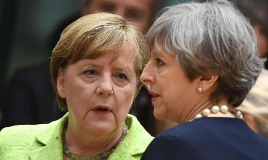 Germany's chancellor Angela Merkel, left, with the British prime minister, Theresa May, last June at an EU leaders' summit in Brussels.