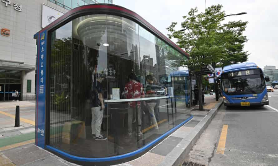 A bus shelter designed to protect passengers from monsoon rains, summer heat and coronavirus in Seoul, South Korea.