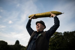 Grower Graham Barratt holds aloft his 92cm-long cucumber which won first prize in the longest cucumber category