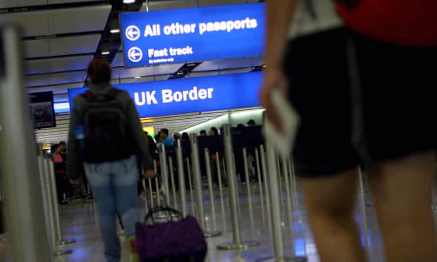 Passengers arriving in the UK at Heathrow airport.
