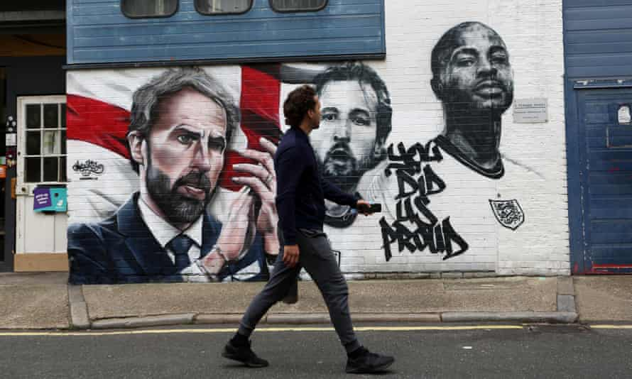 A mural featuring England manager Gareth Southgate, captain Harry Kane and forward Raheem Sterling includes the graffiti: 'You did us proud.'
