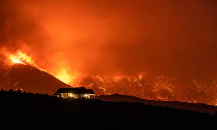 The Slink fire burns towards a home on the edge of Walker, California, 31 August 2020.