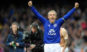 Neville celebrates during his time as Everton captain