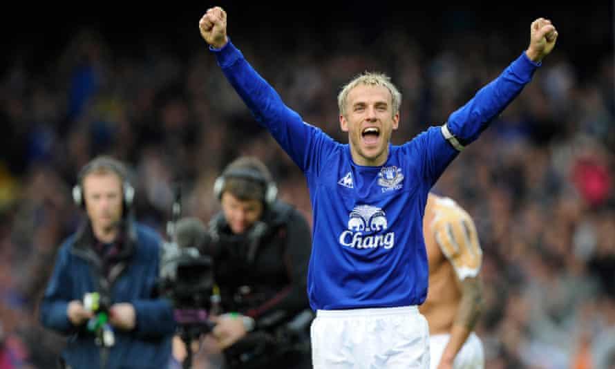 Neville celebrates during his time as Everton captain