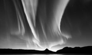 An aurora stretches upwards in this dramatic black and white image.