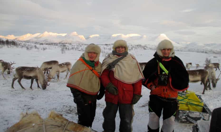 Sami reindeer herders tend to their animals near Tromso, Norway.