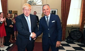 Boris Johnson shakes hands with Mark Sedwill at No 10 Downing Street on 24 July 2019.