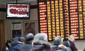 Chinese investors look at share prices as financial markets fall after brief rally.