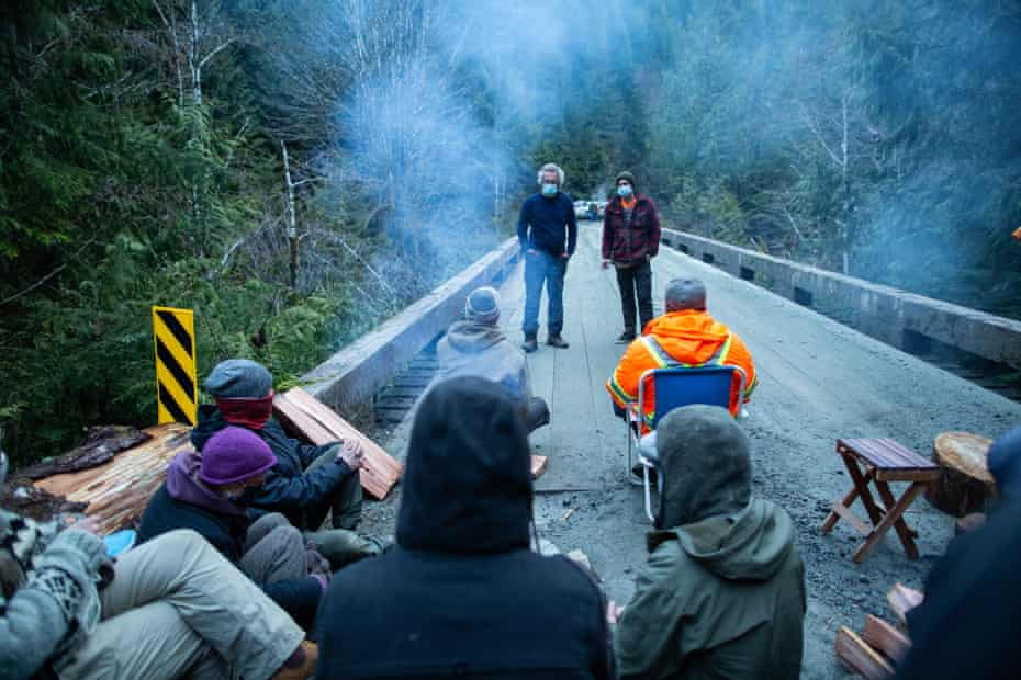Members of the Rainforest Flying Squad speak with logging contractors after refusing to let them cross a bridge to an active cut block.