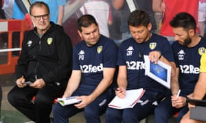 Marcelo Bielsa sits with his backroom staff