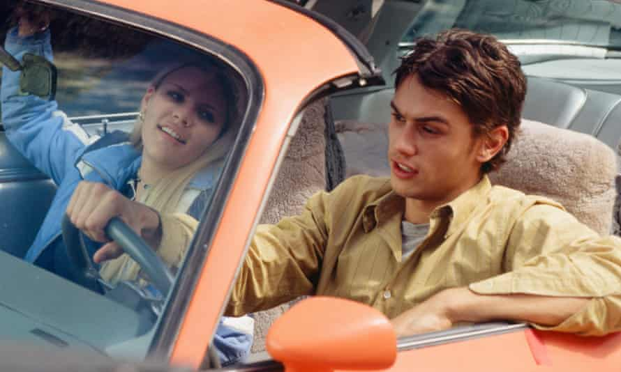 Busy Philipps and James Franco in a car in a scene from Freaks and Geeks