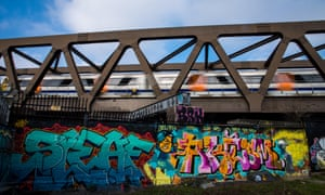 Trackside daredevils … graffiti on an east London bridge.