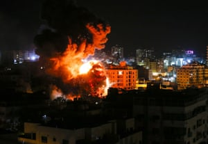 Gaza City, Gaza Fire and smoke below above buildings during Israeli strikes. Israel's military launched strikes on Hamas targets in the Gaza Strip today, the army and witnesses said, hours after a rocket from the Palestinian enclave hit a house and wounded seven Israelis.