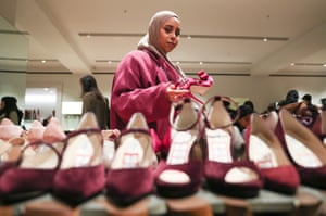 A woman browses luxury shoes in Selfridges, London