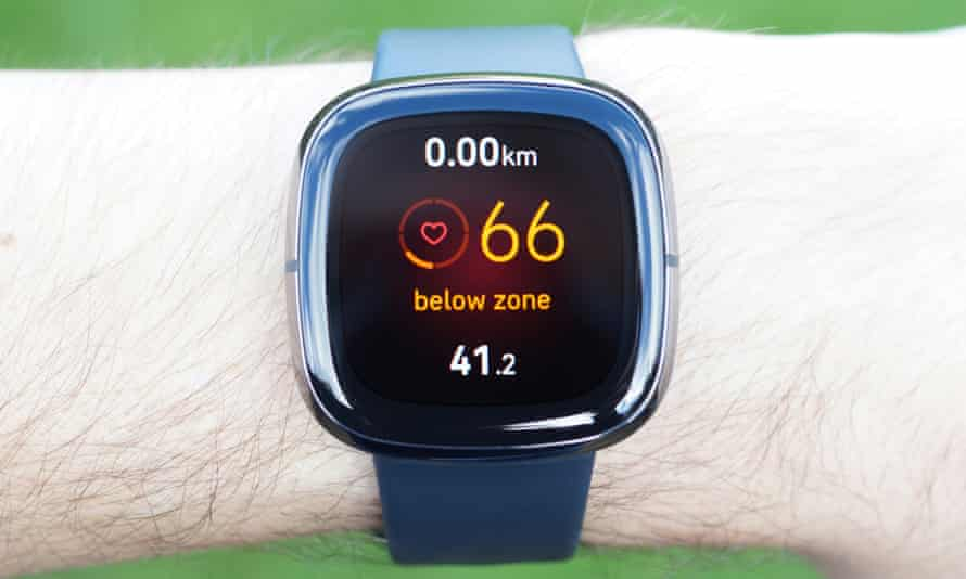 Fitbit Sense on wrist, showing heart rate