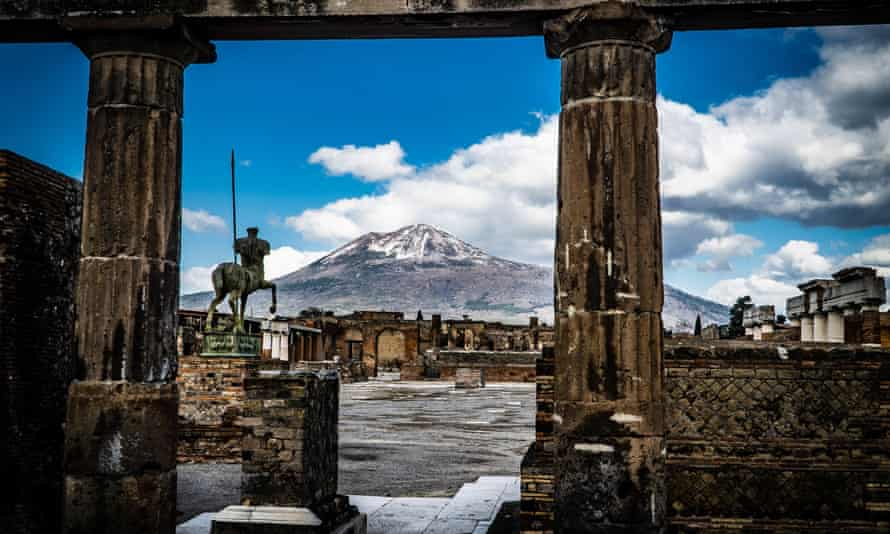 The snow-covered peak of Mount Vesuvius is seen from the streets of the archaeological site in Pompeii, Italy, in February.