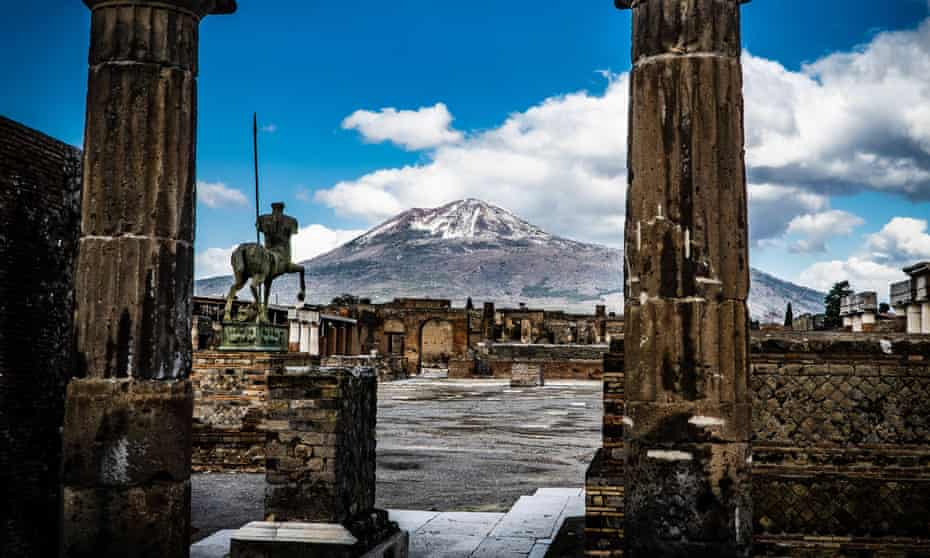 Pompeii in February with the snow-covered peak of Mount Vesuvius in the background.