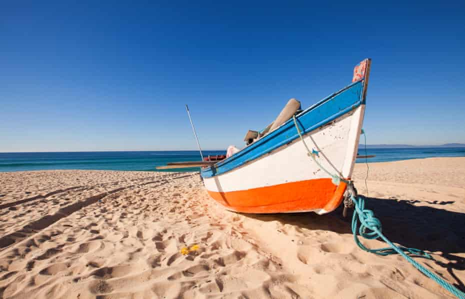 Fisherman's boat on the beach, at Troia, Portugal.