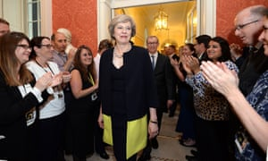 Staff clap as new PM Theresa May walks into 10 Downing Street.