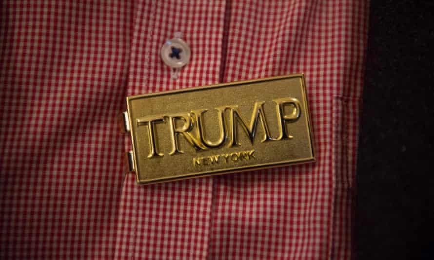 A Donald Trump supporter wears a Trump pin