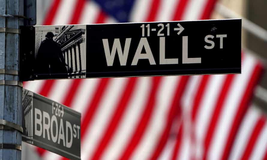 FILE PHOTO: FILE PHOTO: A Wall Street sign is pictured outside the New York Stock Exchange in New York<br>FILE PHOTO: A Wall Street sign outside the New York Stock Exchange in the Manhattan borough of New York City, New York, U.S., April 16, 2021. REUTERS/Carlo Allegri/File Photo