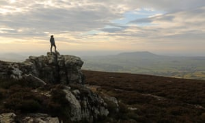 Man on high rock, stiperstones ridge