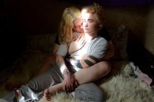 Ignat, a transgender man, sits with his girlfriend Maria in Saint Petersburg, Russia