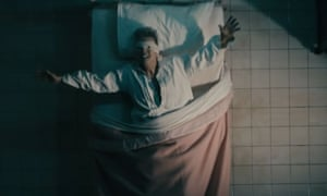 Screengrab of David Bowie in the video for Lazarus