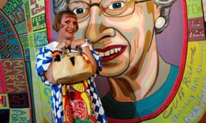 Artist Grayson Perry poses in front of his art work 'Comfort Blanket, 2014'.