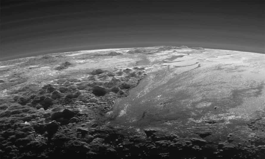 The atmosphere and surface features of Pluto, lit from behind by the sun.