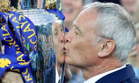 Claudio Ranieri kisses the Premier League trophy