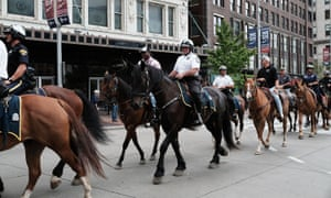 Security personnel on horseback ride through downtown Cleveland on Saturday.