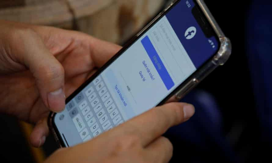 A person using Facebook at a cafe in Hanoi, Vietnam,