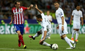 Cristiano Ronaldo of Real and Diego Godín of Atletico clash during a Madrid derby