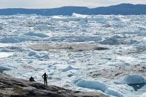 Visitors look out on to the free-floating ice