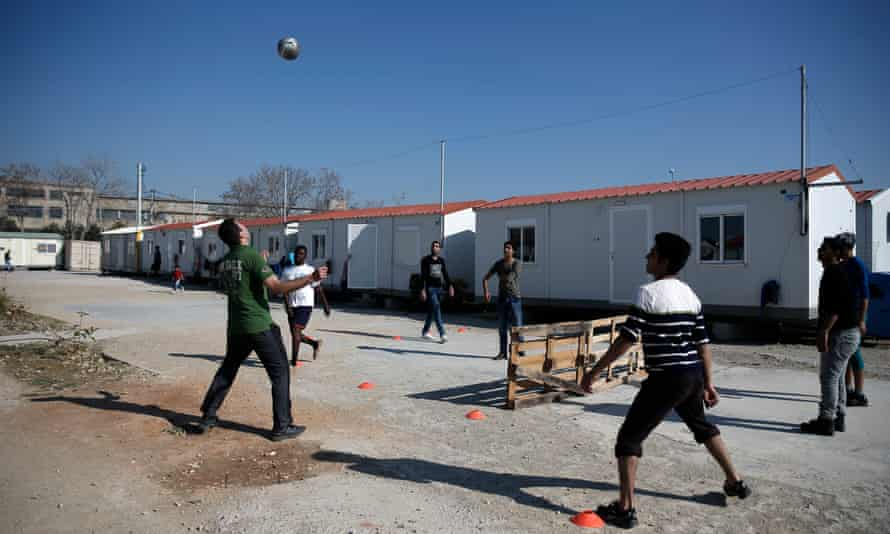 Migrants play soccer at the Eleonas refugee camp in Athens. Eleonas is filling up as thousands are prevented from continuing their journey north.
