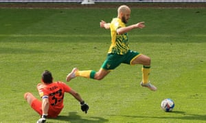 Teemu Pukki rounds the 'keeper to score the Canaries' fourth goal.