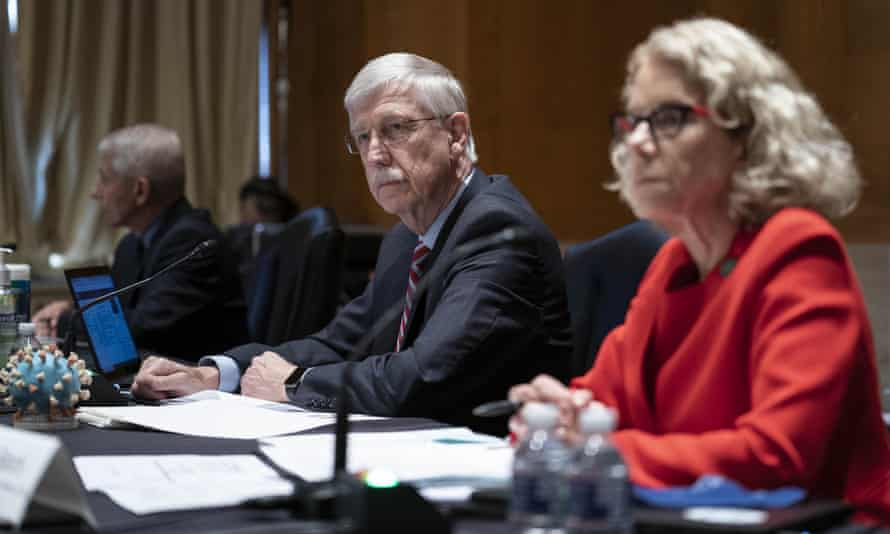 Dr Francis Collins listens during a Senate subcommittee hearing.