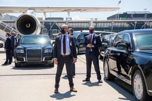 Security personnel guard the Russian presidential limousines