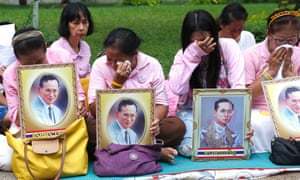 Women weep outside a hospital where Bhumibol was treated in Bangkok.