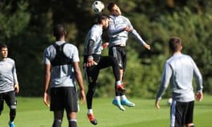 Rui Patricio butts his head into Bruno Jordão's shoulder during Wolves training.