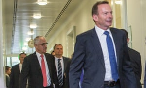 Malcolm Turnbull and Tony Abbott leave a Coalition joint party room meeting.