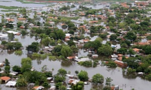 An aerial view of flooded houses in the neighbourhood of Asuncion, Paraguay on 28 December 2015.